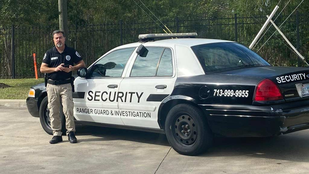 Ranger security guard with patrol vehicle